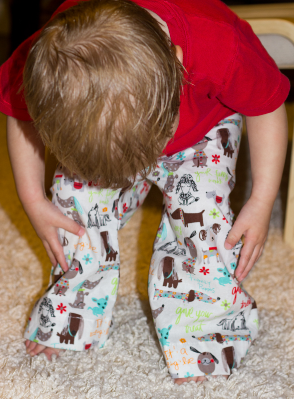 Couldn't resist this picture! He is in love with the doggies on his pants and wants to wear them all day! Makes this mama quite happy when her clothes are appreciated so much :)